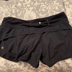 lululemon athletica Shorts - Black lulu Sz 8 shorts with small tear in lining